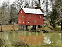 York Gristmill. This is a Winter picture of the iconic York Gristmill on the Wolf Run River located in Pall Mall, Tennessee in Fentress County. This two-story royalty free stock photo