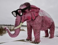 Pink Elephant in Snowstorm. This is a Winter picture of a large Pink fiberglass elephant in a snowstorm located in DeForest, Wisconsin in Dane County.  This Royalty Free Stock Photos