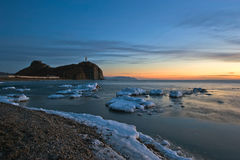 Winter picture lighthouse on a lonely rock. East (Japan) Sea. Stock Images