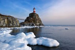 Winter picture lighthouse on a lonely rock. Royalty Free Stock Photos
