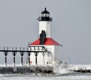 Michigan City Breakwater Lighthouse #2. This is a Winter picture of the northside of the Michigan City Breakwater Lighthouse on Lake Michigan at the end of the royalty free stock photo