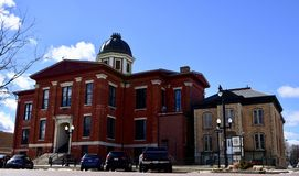 Old Courthouse and Jail. This is a Winter picture of he old McHenry County Courthouse And Jail located on the Woodstock Town Square in Woodstock, Illinois in Stock Image