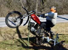 Pumpkin Head Motorcycle Rider. This is a Winter picture of a piece of public art created for the Halloween Season of a Pumpkin headed Motorcycle rider, located Stock Images