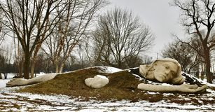 Awaking Muse. This is a Winter picture of a piece of public art titled: Awaking Muse, on exhibit in the Chicago Anthenaeum's International Sculpture Park royalty free stock images