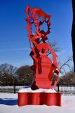 Flamenco Revisited. This is a Winter picture of the public art piece titled: Flamenco Revisited, located on the snow covered grounds of the Garfield Park royalty free stock photography