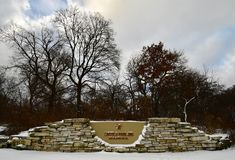 Snow Covered North Entrance of Lincoln Park Zoo. This is a Winter picture of the snow covered North Entrance of iconic Lincoln spark Zoo located in Chicago royalty free stock photography