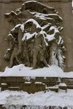 The Pioneers. This is a Winter picture on a snowy day of a piece of public art titled: The Pioneers on the Northwest Bridge Tender's House on the Michigan Royalty Free Stock Photos