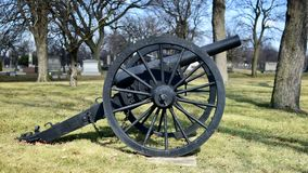 Union Canon. This is a Winter picture of a Union Canon exhibited as part of the Confederate Mound Monument at the Oak Woods Cemetery located in Chicago, Illinois Royalty Free Stock Photos