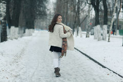 Winter pictures running and jumping girl. Funny winter pictures running and jumping girl Royalty Free Stock Photos