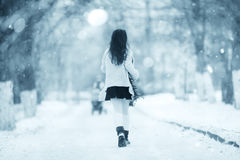 Winter pictures running and jumping girl. Funny winter pictures running and jumping girl Royalty Free Stock Image