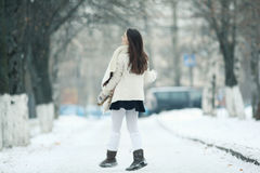 Winter pictures running and jumping girl Royalty Free Stock Image