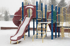 Winter playground equipment, slides Royalty Free Stock Photo