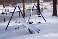 Winter Playground Swingset Equipment. An image depicting what winter does to backyard playground  swing set equipment Stock Photo