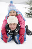 Winter playing. Mother and daughter playing at winter Stock Images