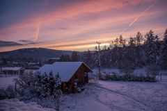 Winter Plešivec Hill in Czech in Winter scenery with alpenglow royalty free stock image