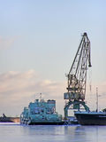 Winter port with crane Royalty Free Stock Photos