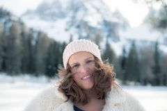 Winter portait of a woman. Winter portait of a beautiful woman in the Italian mountains Royalty Free Stock Images