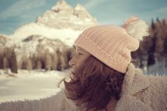 Winter portait of a woman. Winter portait of a beautiful woman in the Italian mountains Royalty Free Stock Photo