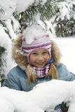 Winter portrait. The joyful girl near a fur-tree Royalty Free Stock Photography