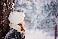 Winter portrait of adorable child girl in grey fur coat in snowy forest Stock Photography