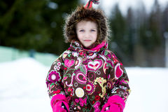 Winter portrait of adorable child girl in jumper Stock Photography