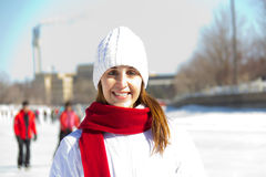 Winter portrait of an attractive woman with a red scarf Royalty Free Stock Photos