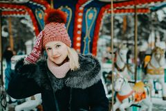 Winter portrait of the beautiful blond girl outdoor stock image