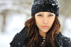 Winter portrait of a beautiful brunette Royalty Free Stock Photos