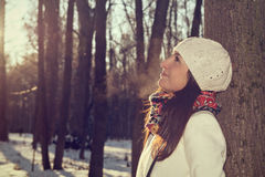Winter portrait of a beautiful cheerful girl. Royalty Free Stock Images