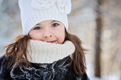 Winter portrait of beautiful child girl in white hat Royalty Free Stock Images