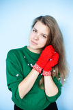 Winter portrait of beautiful girl. Beautiful girl in a sweater, mittens and snowflakes Royalty Free Stock Photography