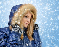 Winter portrait girl. Winter portrait of a beautiful girl with falling snow Stock Photo