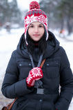 Winter portrait of a beautiful girl in the winter park royalty free stock photography