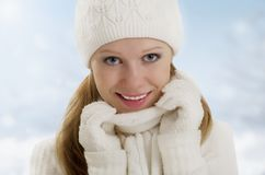 Winter portrait of a beautiful happy girl Royalty Free Stock Photos