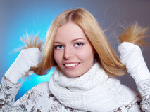Winter portrait of a beautiful laughing girl. With white scarf Royalty Free Stock Images
