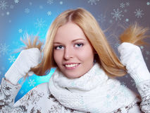Winter portrait of a beautiful laughing girl. With white scarf Stock Photo