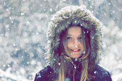 Winter portrait of a beautiful little girl smiling at the camera Royalty Free Stock Photo