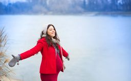 Winter portrait of beautiful pregnant woman Stock Photo