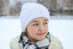 Winter portrait of beautiful smiling little girl with droplets on her eyelashes stock photo