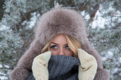 Winter portrait of beautiful smiling woman with snowflakes in white furs. Snow Royalty Free Stock Photo