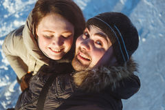 Winter portrait of beautiful traveling couple,hiker laughing couple, emotional man and tongue girl,crazy selfie,hikers. Winter portrait of beautiful traveling Royalty Free Stock Photos