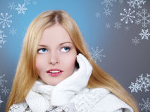 Winter portrait of a beautiful woman is freezing Stock Photo