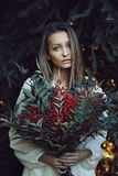 Winter portrait of beautiful woman. Pine branches as background Royalty Free Stock Photo