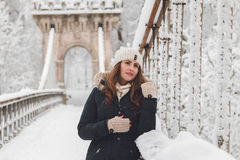 Winter portrait of a beautiful woman in the snowfall Royalty Free Stock Image