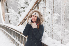 Winter portrait of a beautiful woman in the snowfall Royalty Free Stock Images