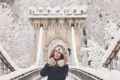 Winter portrait of a beautiful woman in the snowfall Royalty Free Stock Photo