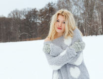 Winter portrait of a beautiful young girl. Warm colour Stock Photos