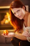 Winter portrait of beauty by fireplace Stock Photo