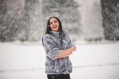 Winter portrait of Beauty girl with snow. With film effect with small grain Royalty Free Stock Photos