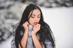 Winter portrait of Beauty girl with snow. With film effect with small grain Royalty Free Stock Photography